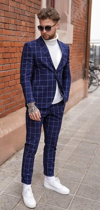 How to wear: black sunglasses, white leather low top sneakers, white knit turtleneck, navy check suit