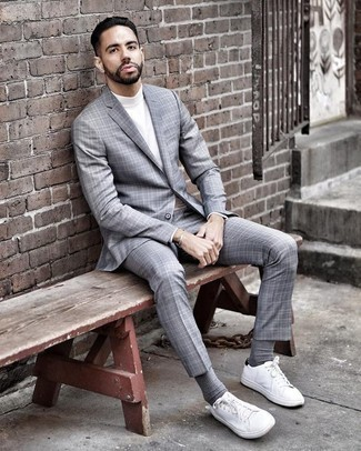 How to Wear a Grey Plaid Suit: For an outfit that's city-style-worthy and effortlessly neat, opt for a grey plaid suit and a white turtleneck. To give your overall outfit a more casual aesthetic, complete your ensemble with white canvas low top sneakers. This getup shows that well into your 30s your outfit options are pretty much limitless.