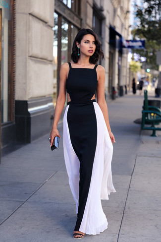 How to wear: black and white maxi dress, black suede heeled sandals, black clutch, green earrings
