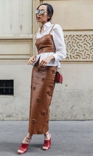How to wear: red leather heeled sandals, brown leather maxi skirt, brown leather bustier top, white dress shirt