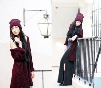 How to wear: black leather ankle boots, black slit maxi skirt, black cropped top, burgundy fur coat