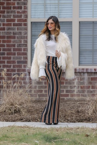 How to wear: black leather pumps, multi colored vertical striped maxi skirt, white ruffle long sleeve blouse, white fur jacket