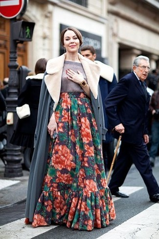How to wear: gold bracelet, multi colored floral maxi skirt, grey short sleeve sweater, grey fur collar coat