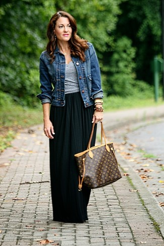 How to wear: dark brown print leather tote bag, black pleated maxi skirt, grey v-neck t-shirt, navy denim jacket