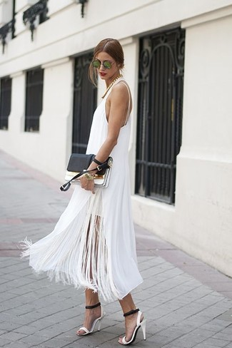 How to wear: white fringe midi dress, white and black leather heeled sandals, black and white leather clutch, green sunglasses