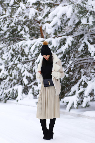 How to wear: black suede knee high boots, beige pleated midi skirt, black cowl-neck sweater, beige shearling jacket