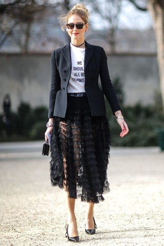 How to wear: black leather pumps, black fringe midi skirt, white and black print crew-neck t-shirt, black blazer