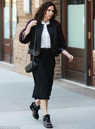 How to wear: black suede wedge sneakers, black midi skirt, white silk dress shirt, black wool biker jacket