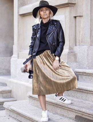 How to wear: white and black leather low top sneakers, gold pleated midi skirt, black turtleneck, black leather biker jacket