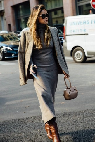 How to Wear a Grey Turtleneck For Women: So as you can see, looking sophisticated doesn't take that much time. Pair a grey turtleneck with a grey wool midi skirt and you'll look seriously chic. This outfit is complemented nicely with a pair of brown leather mid-calf boots.