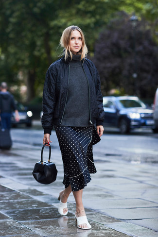How to wear: white leather mules, black and white polka dot midi skirt, charcoal wool turtleneck, black quilted bomber jacket