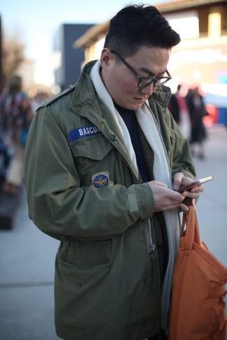 How to wear: olive military jacket, charcoal plaid blazer, navy turtleneck, orange leather tote bag