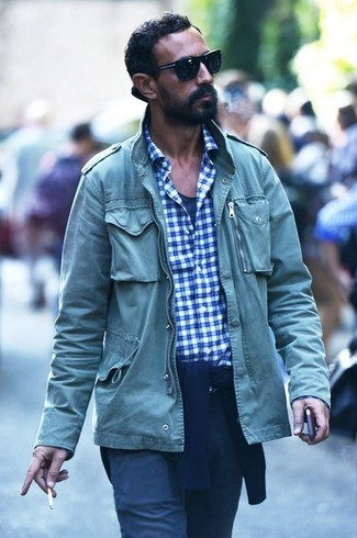 How to wear: green military jacket, navy crew-neck sweater, white and blue gingham long sleeve shirt, navy tank