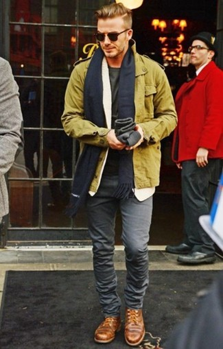 David Beckham wearing Olive Military Jacket, Olive Crew-neck T-shirt, Grey Skinny Jeans, Brown Leather Derby Shoes