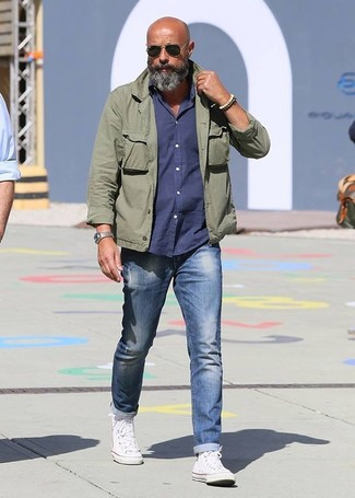 How to wear: olive military jacket, navy long sleeve shirt, blue jeans, white high top sneakers
