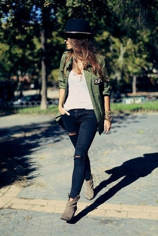 Make an army green military jacket and a hat your outfit choice, if you feel like comfort dressing without looking like a hobo. And it's a wonder what a pair of beige suede ankle boots can do for the look. You can bet this combination is the answer to all of your transeasonal wear woes.