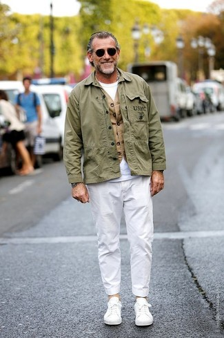 How to wear: olive military jacket, tan waistcoat, white crew-neck t-shirt, white chinos