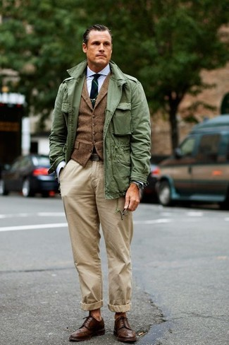 How to wear: olive military jacket, brown wool waistcoat, light blue gingham dress shirt, beige chinos