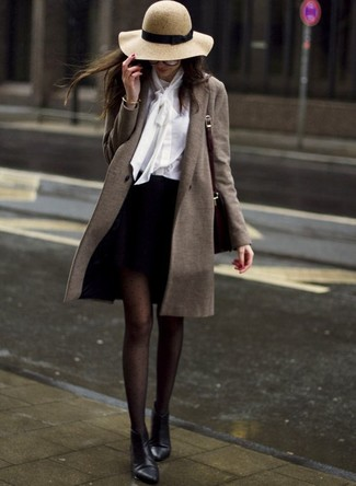 How to wear: black leather ankle boots, black mini skirt, white button down blouse, olive coat