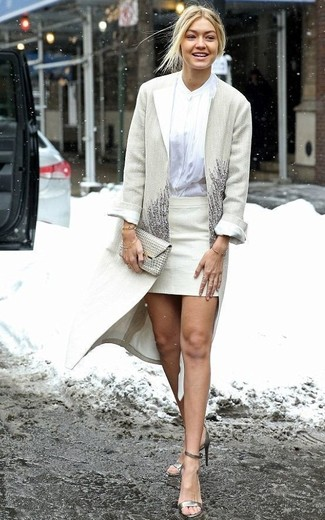 How to wear: gold leather heeled sandals, beige mini skirt, white button down blouse, beige coat