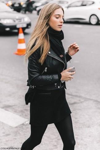 How to wear: black scarf, black wool mini skirt, black crew-neck sweater, black leather biker jacket