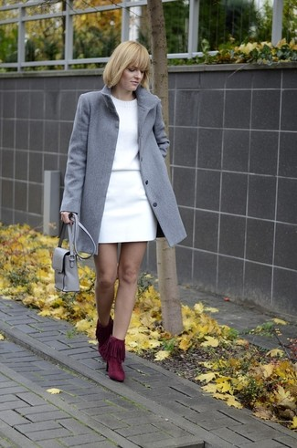 How to wear: burgundy fringe suede ankle boots, white mini skirt, white crew-neck sweater, grey coat