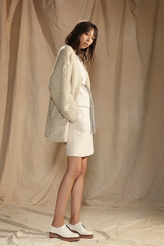 How to wear: white leather oxford shoes, white knit mini skirt, white crew-neck sweater, beige fleece coat