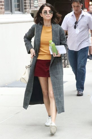 How to wear: white canvas low top sneakers, burgundy suede mini skirt, orange crew-neck sweater, grey plaid coat
