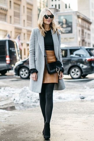 How to wear: black suede ankle boots, tan leather mini skirt, black crew-neck sweater, grey coat