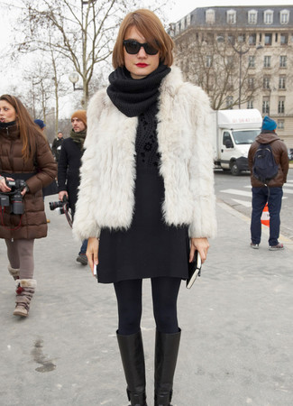 How to wear: black leather knee high boots, black wool mini skirt, black floral crew-neck sweater, white fur jacket