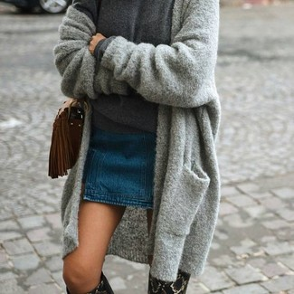 How to wear: black snake leather knee high boots, blue denim mini skirt, charcoal crew-neck sweater, grey knit open cardigan