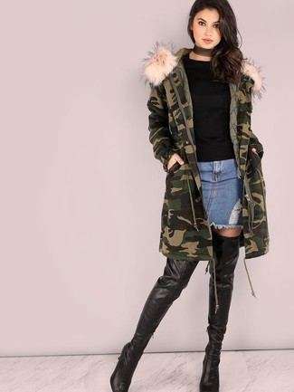 How to wear: black leather over the knee boots, blue denim mini skirt, black crew-neck sweater, dark green camouflage parka