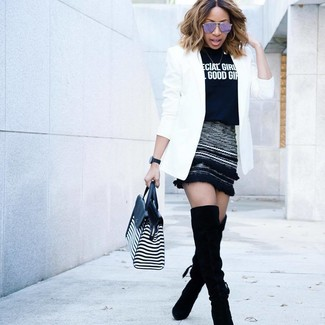 How to wear: black suede over the knee boots, black wool mini skirt, black and white print crew-neck t-shirt, white blazer