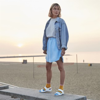How to Wear a Jacket For Women: If the setting permits a casual getup, dress in a jacket and a light blue mini skirt. Infuse a dose of playfulness into this outfit by rounding off with white leather flat sandals.