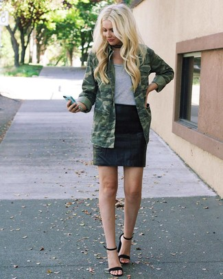 How to wear: black suede heeled sandals, black leather mini skirt, grey crew-neck t-shirt, olive camouflage military jacket