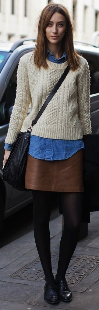 How to wear: black leather oxford shoes, brown leather mini skirt, blue denim shirt, beige cable sweater