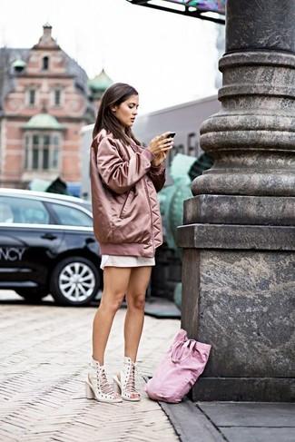 How to wear: white leather heeled sandals, white mini skirt, white dress shirt, pink bomber jacket