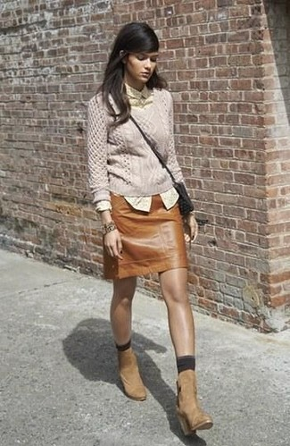 How to wear: tan suede ankle boots, brown leather mini skirt, yellow polka dot dress shirt, beige cable sweater