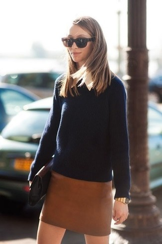 How to wear: black leather clutch, brown leather mini skirt, white dress shirt, navy crew-neck sweater