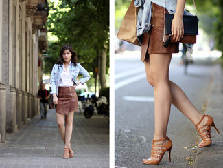 How to wear: brown leather gladiator sandals, brown leather mini skirt, white dress shirt, light blue denim jacket