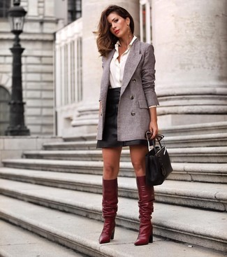 How to wear: burgundy leather knee high boots, black leather mini skirt, white dress shirt, grey double breasted blazer