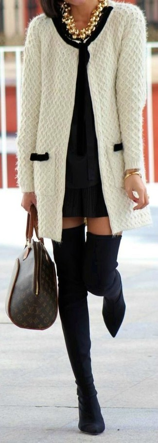 How to wear: black suede over the knee boots, black pleated mini skirt, black long sleeve blouse, white knit open cardigan