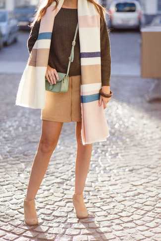 How to Wear Tan Suede Ankle Boots: This combo of an olive knit oversized sweater and a tan wool mini skirt is a safe go-to for an effortlessly cool getup. And if you wish to easily up the style ante of your look with one piece, why not complete your look with a pair of tan suede ankle boots?