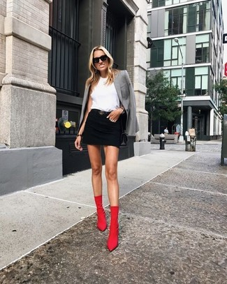 How to wear: red elastic ankle boots, black denim mini skirt, white sleeveless top, grey blazer
