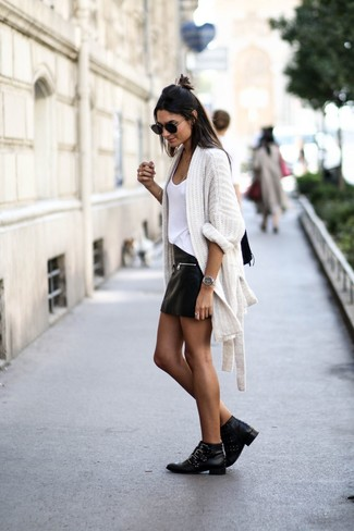 How to wear: black studded leather ankle boots, black leather mini skirt, white tank, white knit open cardigan