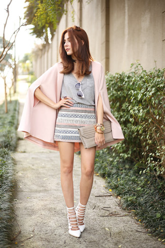 Women's Looks & Outfits: What To Wear In 2020: A pink cape blazer and a grey geometric mini skirt are the kind of a never-failing off-duty outfit that you need when you have zero time to spare. For something more on the sophisticated side to complete this ensemble, add white leather heeled sandals to the mix.