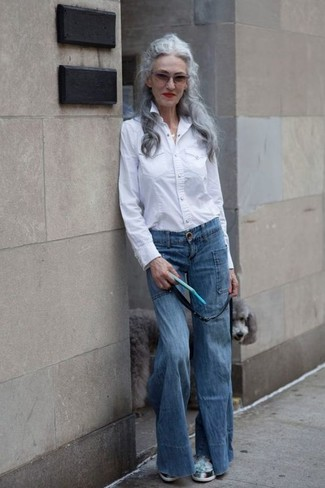 How to wear: mint athletic shoes, blue flare jeans, white dress shirt