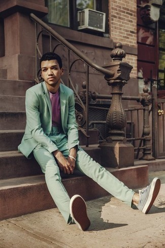 How to Wear a Green Suit: Putting together a green suit and a pink crew-neck t-shirt will hallmark your prowess in menswear styling. Mint canvas low top sneakers are the simplest way to upgrade your outfit.