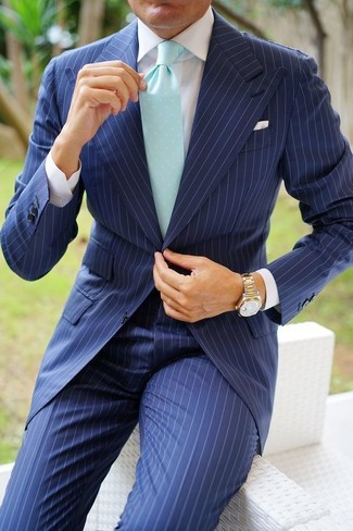 How to wear: gold watch, mint tie, white dress shirt, navy vertical striped suit