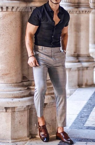 How to Wear a Navy Short Sleeve Shirt For Men: Rock a navy short sleeve shirt with grey check chinos for a casual and trendy getup. Make a bit more effort with footwear and complete your look with a pair of brown leather monks.
